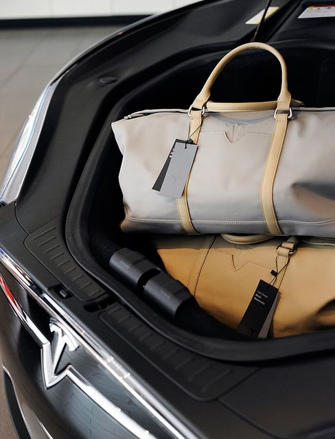 Tesla bags, made from leather that was left over from the car's interior, are seen in the front trunk of a Model S 85.