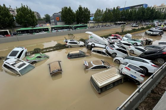 China's 'iPhone City' Relocates 100,000 AfterFloods Leave 12 Dead