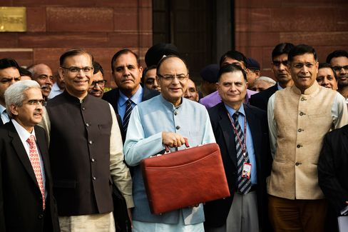 Arun Jaitley stands before leaving to table the budget in parliament in New Delhi.
