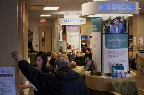 Customers Wait at a UnitedHealthcare Store in New York