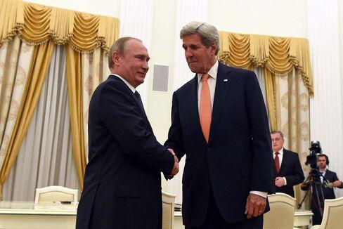 John Kerry, right, and Vladimir Putin on July 14.