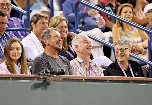Kahn and Ellison take in a match in March with McEnroe and Bill Gates.
