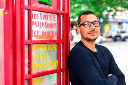 Umar Khalid, co-owner of the Kape Barako phone booth coffee stall