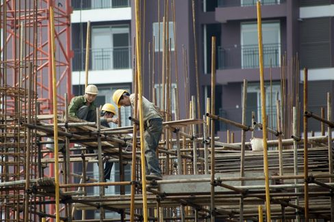 Workers Labor on a Social Housing Project