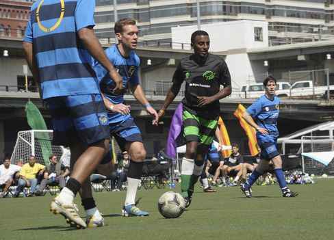 Soccer player Eddie Lewis and chef Marcus Samuelsson participate in the Tribeca/NYFEST Soccer Day - Celebrity Match during the 2012 Tribeca Film Festival at the Pier 40 on April 21, 2012.