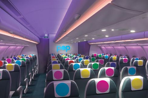 An artist's impression showing the interior of a POP Airline aircraft.