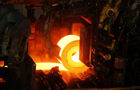 Red-Hot Rolled Steel Coil is Run through Rollers at a Steel Mill