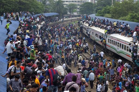 Overcrowded trains at Airport Railway Station in Dhaka.