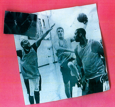 Brown (center) drives for a basket at an Aug. 13 fundraiser in Springfield, Mass. Sports have been central to his appeal
