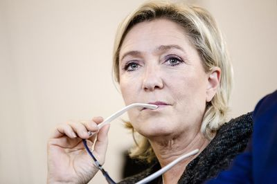 Marine Le Pen, leader of the French National Front, listens during a party debate in Paris, France, on Thursday, Oct. 20, 2016. Once seen as fringe groups, France's National Front, Italy's Five Star Movement, and the Freedom Party in the Netherlands have attracted legions of followers by tapping discontent over immigration, terrorism, and feeble economic performance. Photographer: Marlene Awaad/Bloomberg