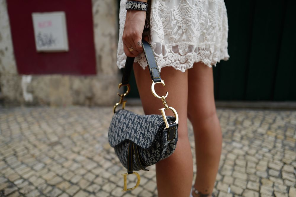 38e846a6881 Dior Brought Back the Saddle Bag With a Global Instagram Blitz ...