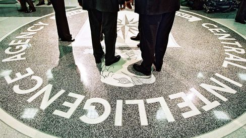 President George W. Bush, Central Intelligence Agency Director George Tenet and others stand on the seal of the Agency March 20, 2001 at the CIA Headquarters in Langley, Virginia.
