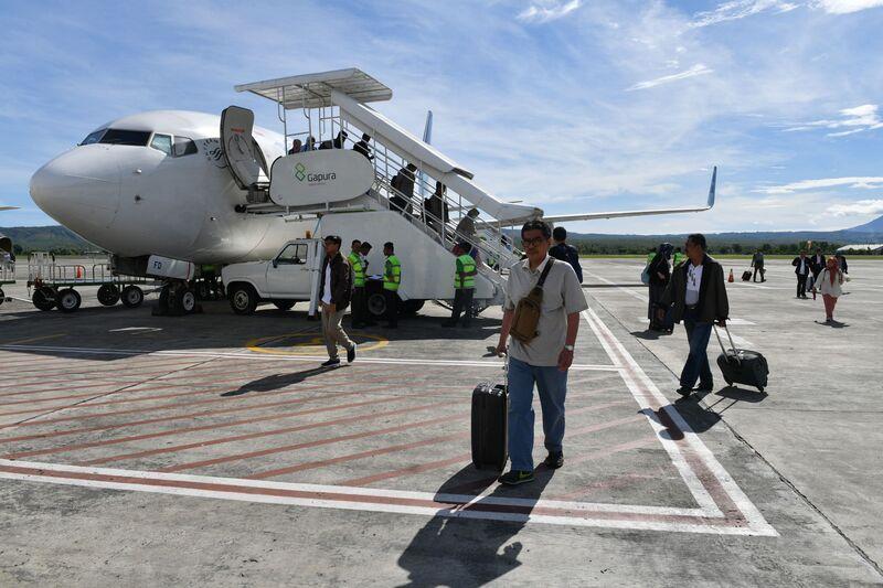 Passengers at Sultan Iskandar Muda Airport, operated by Angkasa Pura II, in Banda Aceh. Image: Adek Berry/AFP via Getty Images