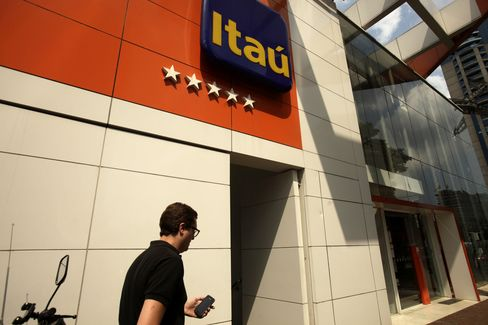 A Man Walks Past a Banco Itau Branch in Sao Paulo