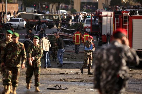 Lebanese Army Troops Inspect the Scene of a Car Bomb in Beirut