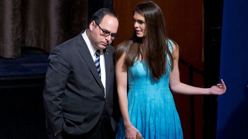 Hope Hicks and George Gigicos appear on stage during a campaign event ...