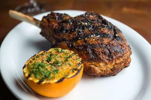The veal chop tastes of chili and fennel, with a buttery sauce that gets better when you squeeze over an orange.