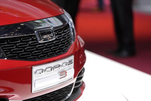 A Qoros 3 Hatch Automobile Sits at the Geneva Motor Show