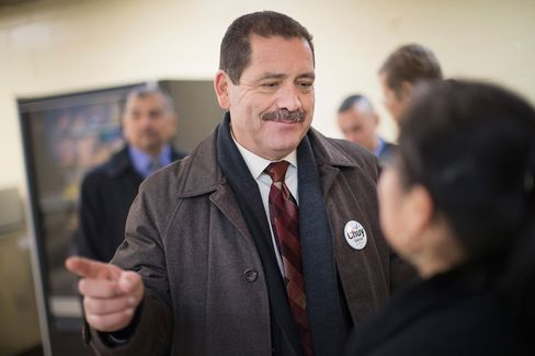 Garcia greets workers during a campaign stop at a linen and uniform service company on February 23.
