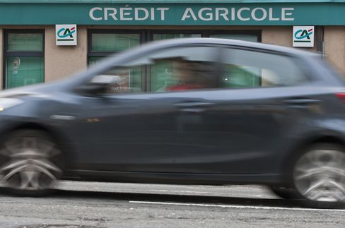 An Automobile Passes a Credit Agricole Branch in Rodez