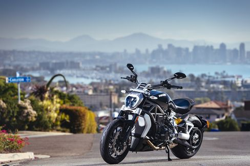 Ducati's XDiavel in front of the San Diego city skyline.