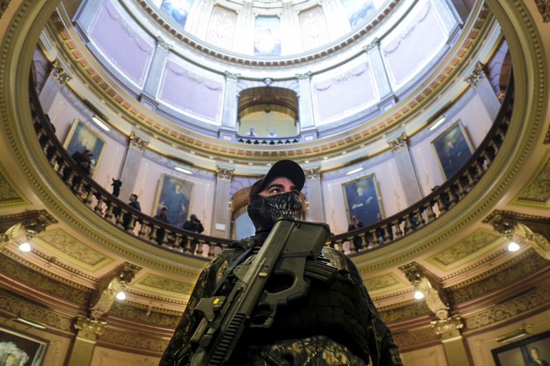 An armed protester stands in the Michigan Capitol Building in Lansing, on April 30.