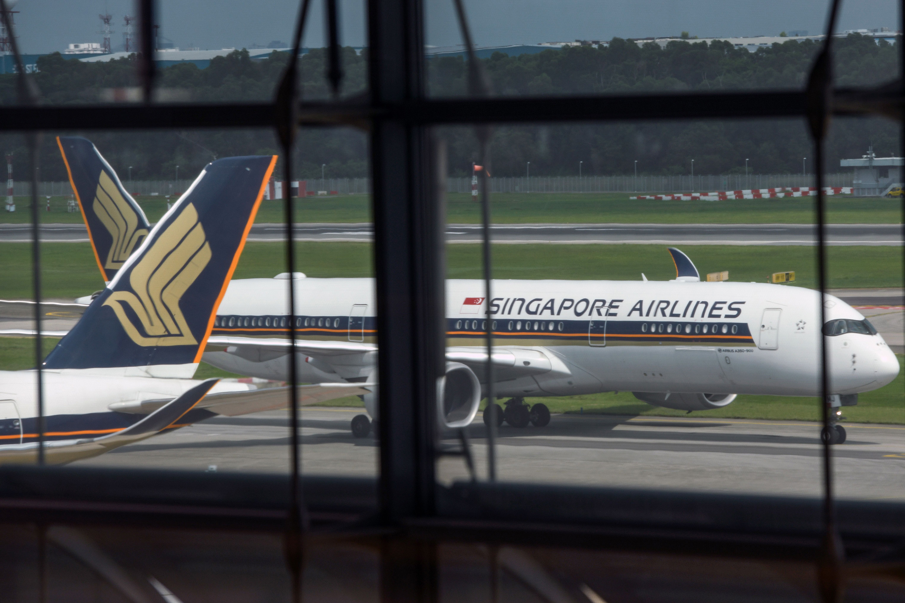 A Singapore Airlines passenger jet taxis along the tarmac as it arrives at Changi International Airport terminal in Singapore on June 8.