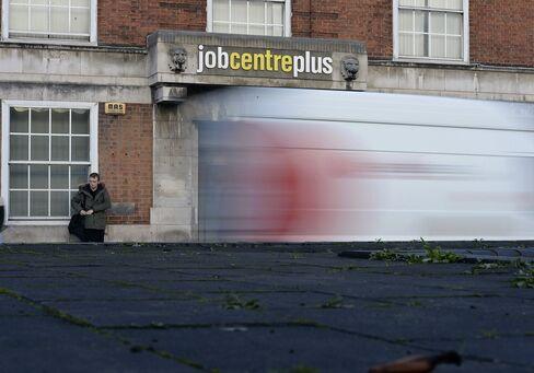 A Pedestrian Waits Outside a Job Centre in Leeds