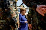 Chancellor Angela Merkel greets members of the NATO unit during a visitin Munster, Germany on May 20.
