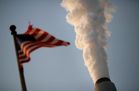 Emissions rise as a U.S. flag flies at the American Electric Power Co. Inc. coal-fired John E. Amos Power Plant in Winfield, West Virginia, U.S., on Thursday, July 31, 2014.