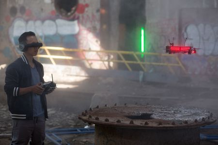 Pilot Ummagawd flies a drone at a Drone Racing League test event at an abandoned New York power plant.