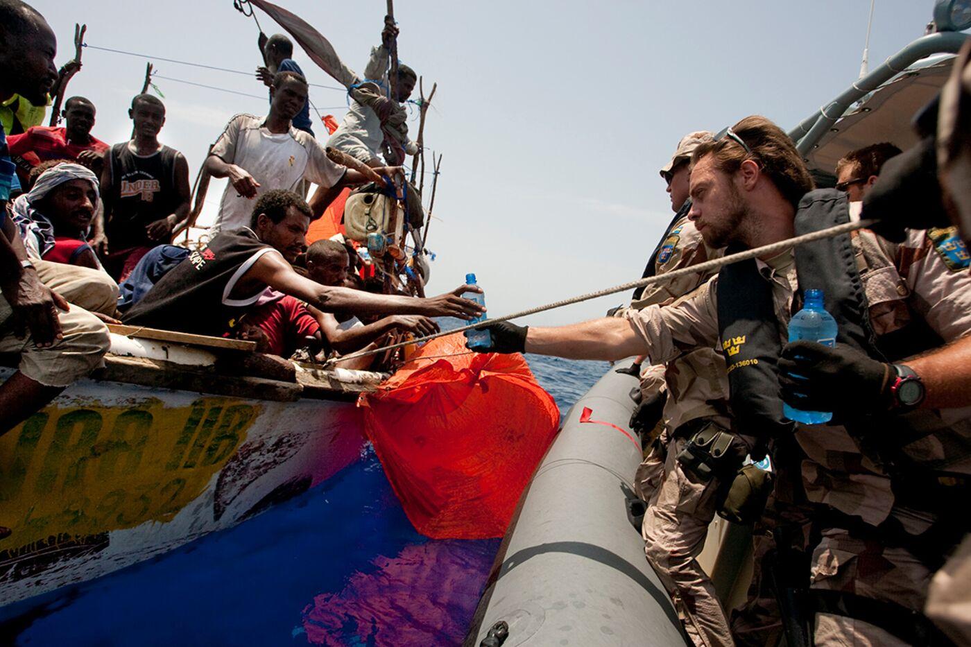 Swedish EU Naval Force frigate HSMS Carlskrona helping Somali seafarers in 2010.