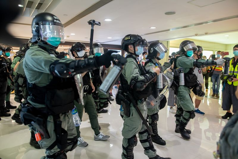 Riot police attempt to disperse crowds inside Harbour City shopping mall, Hong Kong on May 10.