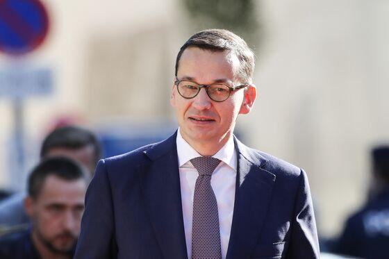 Poland Puts Brave Face on EU Move to Halt Judicial Revamp