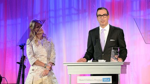 Honorees Heather Mnuchin and Steven Mnuchin, recipients of the Philanthropic Leadership Award, speak onstage during the Kaleidoscope Ball: Designing The Future benefitting the UCLA Children's Discovery and Innovation Institute at Mattel Children's Hospital UCLA on April 17, 2013, in Beverly Hills, California.