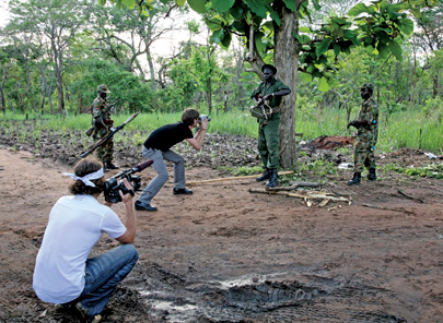 Russell shooting footage of the Sudan People's Liberation Army in 2008 on the Congo-Sudan border