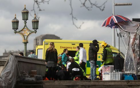 Emergency services tend to an injured individual on Westminster Bridge on March 22.