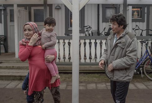 Asylum seekers from Afghanistan look on in a summer holiday resort where they have beenliving for the last 4 months in Halmstad, Sweden.