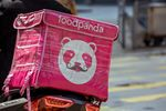 An insulated food bag branded with Foodpanda logo sits on the back of a motorcycle in Hong Kong, China, on Thursday, Feb. 20, 2020.