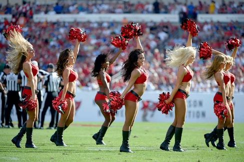 The Latest Cheerleader to Sue a Football Team Says She Made $2 an Hour