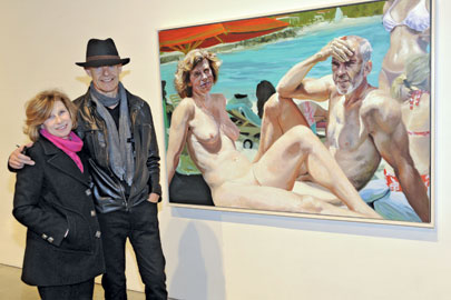 Hall and his wife in front of Fischl's portrait of them