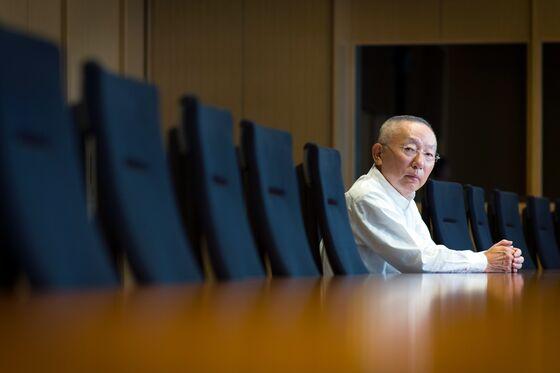 SoftBank Loses Veteran Board Member as Uniqlo Founder Exits
