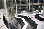 Employees work at the Tokyo Stock Exchange.