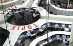 Traders work on the floor of the Tokyo Stock Exchange in Tokyo, Japan.