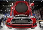 A view of a fully electric Tesla car on an assembly line at the new Tesla Motors car factory.