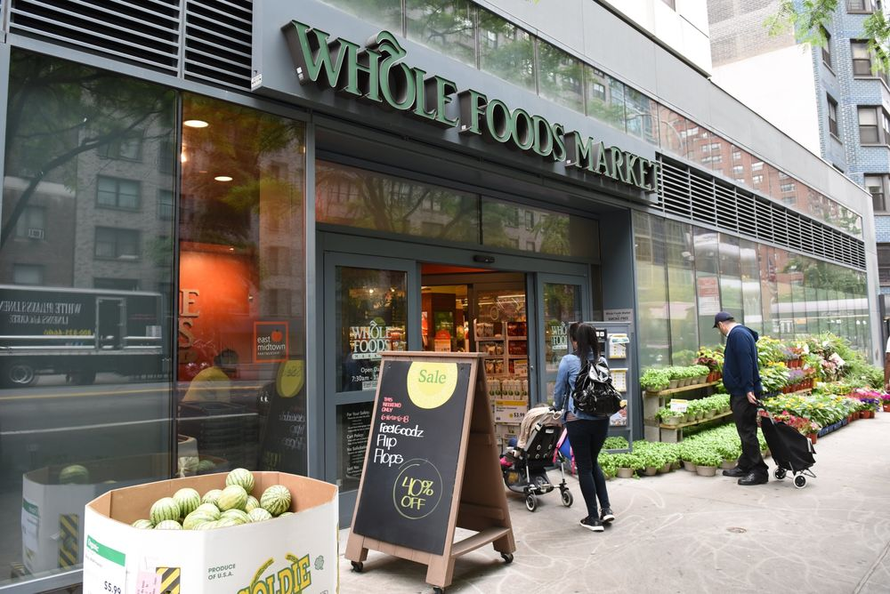 80987eb32d Amazon-Whole Foods Anniversary  Sorting the Groceries - Bloomberg