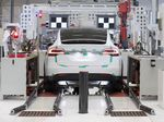 A Tesla Model X sports utility vehicle (SUV) undergoes wheel alignment checks during assembly for the European market at the Tesla Motors Inc. factory in Tilburg, Netherlands.