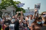 """A woman carries a placard reading """"Freedom for Furgal!"""", during rally in Khabarovsk, Russia, on July 18."""