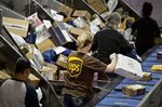 Employees sort packages at the UPS Chicago Area Consolidation Hub in Hodgkins, Illinois, on Dec. 5.