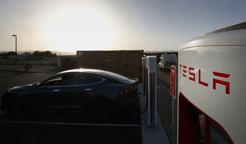 A Tesla Motors Inc. Model S P85D vehicle sits plugged in at a charging station in Nephi, Utah.